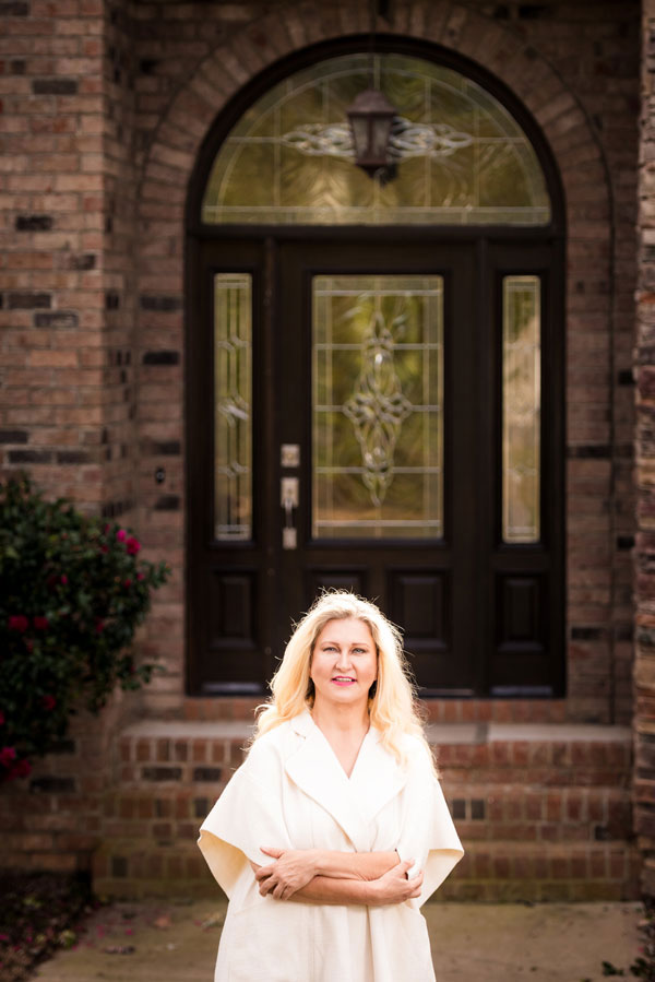 Dr Elisabeth Flachofsky medical aesthetic standing in front of her home office